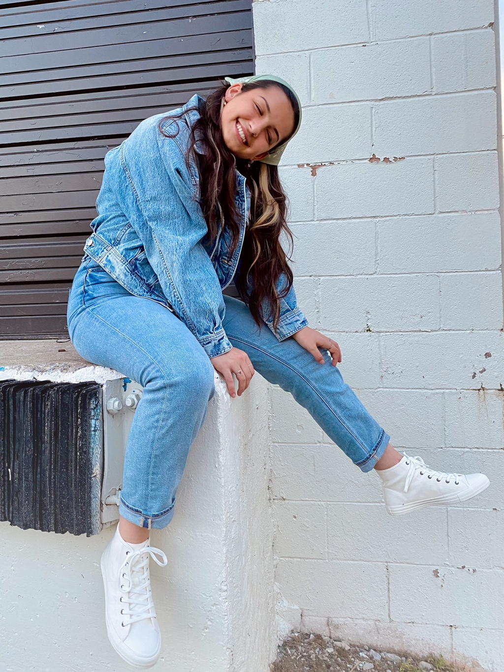 woman wearing a jean jacket and light wash jeans