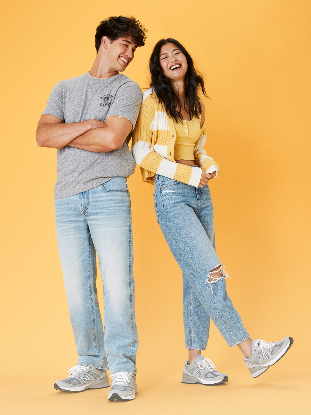man and woman wearing light wash jeans